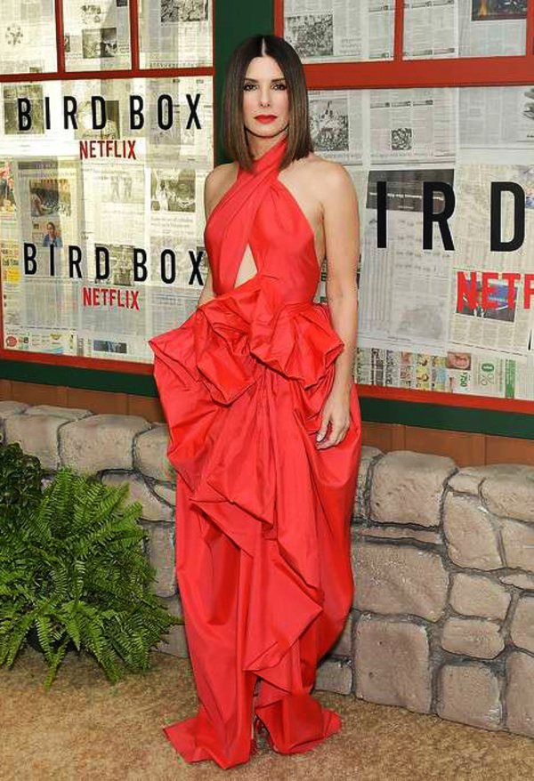 Martin Grant - SANDRA BULLOCK WEARING MARTIN GRANT RED RUFFLED GOWN ATTENDS BIRD BOX SCREENING IN NEW YORK, US